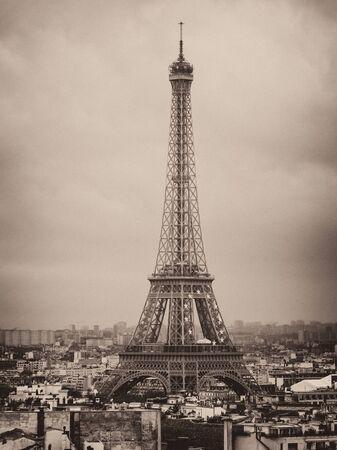 Photo pour Eiffel tower and rooftops, Paris, France, vintage old photo effect, grainy sepia image - image libre de droit