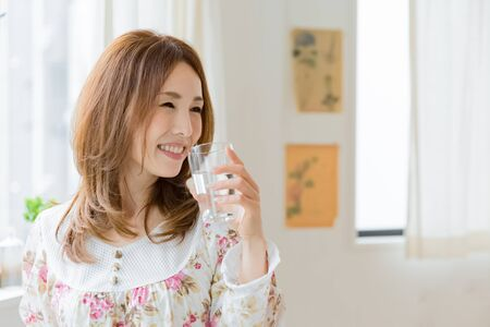 Lady drinking waterの写真素材