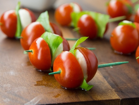 tomato and cheese apetizer on a toothpick