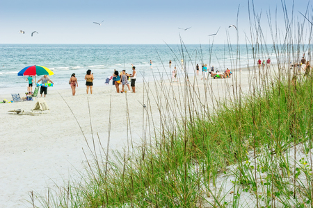 Atlantic Beach, FL - May 23, 2014:  Beach goers enjoy a day on the beach during the summer months at Atlantic Beach near Jacksonville, Florida.