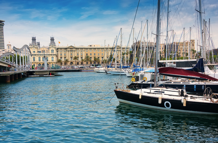 Barcelona, Spain - June 6, 2016: Port Vell (Old Harbor) in Barcelona, Spain is a waterfront marina.  It was built as part of an urban renewal program prior to the 1992 Barcelona Olympics.