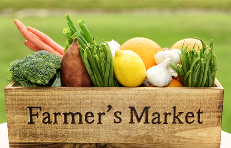 Photo for Variety of fresh produce in a Farmer's Market wooden box. - Royalty Free Image