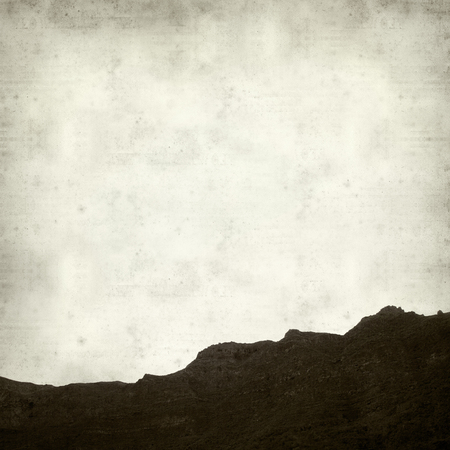 textured old paper background with steep walls slopes of Barranco de Guayadeque, Gran Canaria