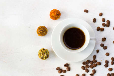 Photo pour Coffee espresso and truffles balls on the plate, coffee and dessert - image libre de droit
