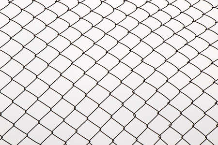 Photo pour Metal fence background, real fence close-up and texture on the white sky background - image libre de droit