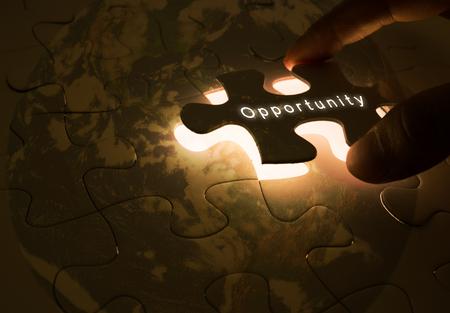 Photo pour opportunity concept with hand opening the  puzzle - image libre de droit