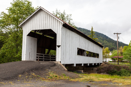 MYRTLE CREEK, OREGON - April 17, 2014:  The historic Horse Creek Covered Bridge now spanning Myrtle Creek on a spring day in Myrtle Creek, OR on April 17, 2014.