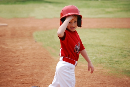 Little league baseball player during a game.