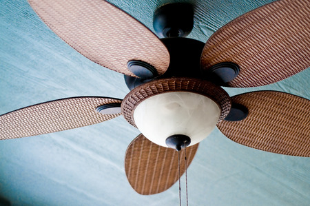 Decorative ceiling fan on porch of home.