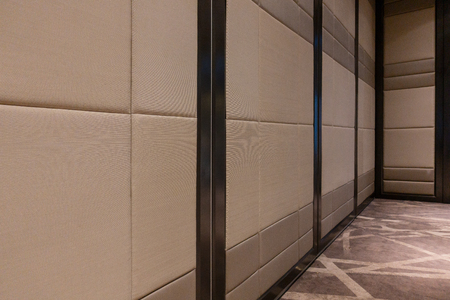 Photo for Fabric panels door covered acoustic board pattern surface texture in hotel. Interior material for design decoration background - Royalty Free Image