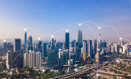 Foto de Digital network connection lines of Kuala Lumpur Downtown, Malaysia. Financial district and business centers in smart city in technology concept. Skyscraper and high-rise buildings at noon - Imagen libre de derechos