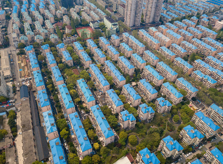 Photo pour Aerial view of blue houses. Residential neighborhood. Urban housing development from above. Top view. Real estate in Shanghai City, China - image libre de droit