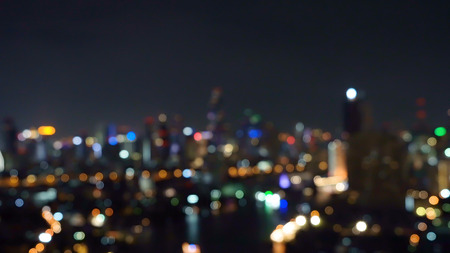 Photo pour Bokeh background of skyscraper buildings in city with lights, Blurry photo at night time. Cityscape - image libre de droit