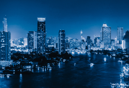 Photo for Aerial view of boats and Taksin Bridge with Chao Phraya River, Bangkok Downtown. Thailand. Financial district and business centers in smart urban city. Skyscraper and high-rise buildings at night. - Royalty Free Image