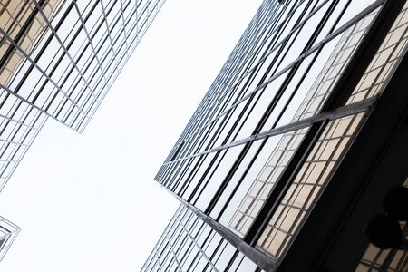Photo pour Golden building. Windows glass of modern office skyscrapers in technology and business concept. Facade design. Construction structure of architecture exterior for urban cityscape background. - image libre de droit