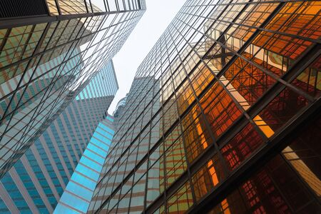 Foto de Golden building. Windows glass of modern office skyscrapers in technology and business concept. Facade design. Construction structure of architecture exterior for urban cityscape background. - Imagen libre de derechos