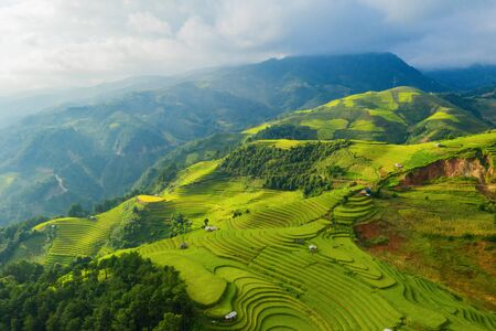 Photo pour Aerial top view of paddy rice terraces, green agricultural fields in countryside or rural area of Mu Cang Chai, Yen Bai, mountain hills valley at sunset in Asia, Vietnam. Nature landscape background. - image libre de droit