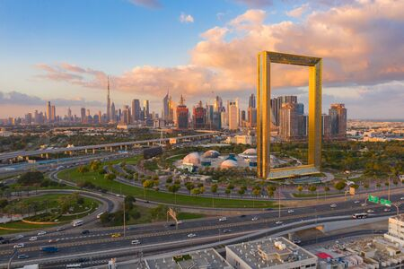 Photo pour Aerial view of Dubai Frame, Downtown skyline, United Arab Emirates or UAE. Financial district and business area in smart urban city. Skyscraper and high-rise buildings at sunset. - image libre de droit