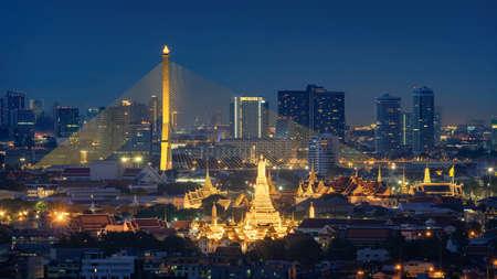 Photo pour Aerial view of Rama 8 Bridge and Temple of Dawn or Wat Arun in Rattanakosin Island in architecture, Urban old town city, Bangkok skyline. downtown area, Thailand at night. - image libre de droit