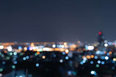 Photo pour Bokeh abstract background of skyscraper buildings in Bangkok city, Thailand with lights, Blurry photo at night time. Cityscape. - image libre de droit