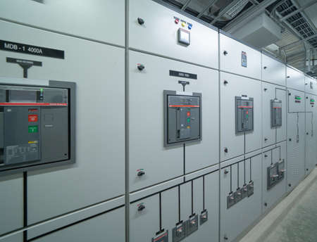 Photo pour Interior of electrical room. Power energy motor machinery cabinets in control or server room, main operator station network and circuit center in industry factory manufacturing system. generator - image libre de droit
