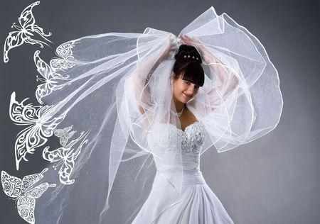 Photo pour Beautiful bride in a white dress with butterflies. Studio shot - image libre de droit