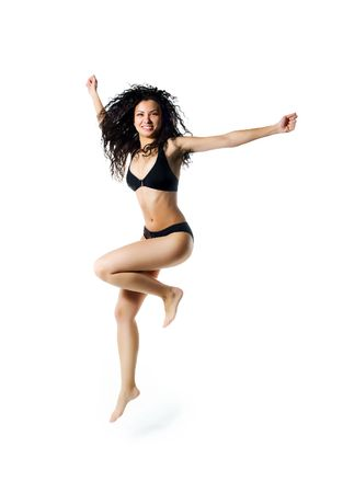 Cute women in swimsuit jumping. White background