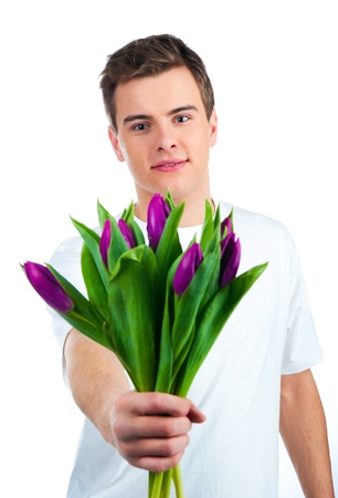 Cute young men give the flowers over white backgroung