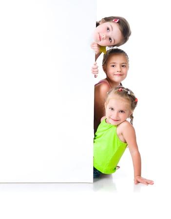 Photo pour Cute little girls isolated - image libre de droit