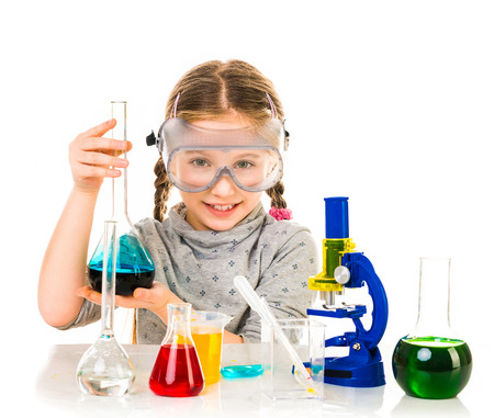 happy little girl with flasks for chemistry isolated on a white background