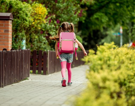 e92c3a4af0 little girl with a backpack run from school  Royalty-free images ...