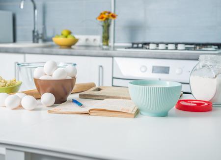 Photo pour ingredients for baking and recioe book on a kitchen table - image libre de droit