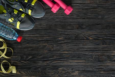 Foto de sport fitness items on dark wooden background with empty text space - Imagen libre de derechos