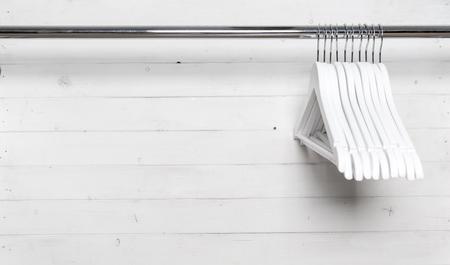 Photo pour White wooden hangers on the side - image libre de droit