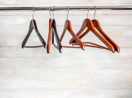 Photo pour Brown wooden hangers on the rack - image libre de droit