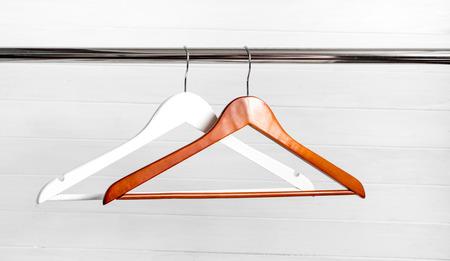 Photo pour wooden hangers on the rack - image libre de droit
