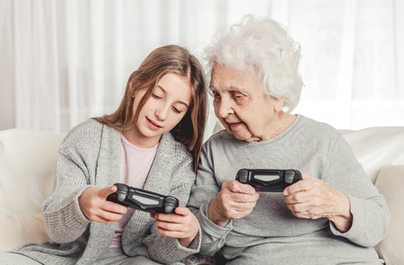 Photo pour Grandmother with granddaughter playing games - image libre de droit