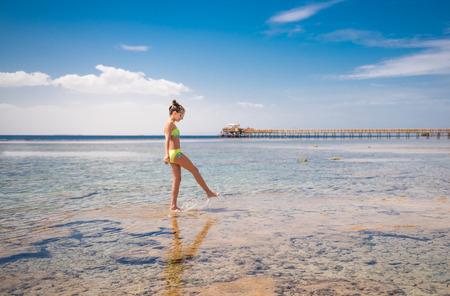 Photo for Teen walking at seashore - Royalty Free Image