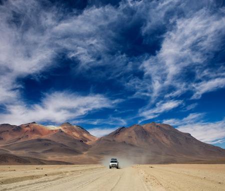 Photo pour Car riding in Bolivian sunshine landscape - image libre de droit