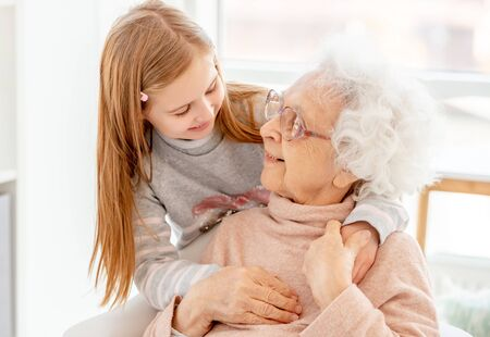 Photo for Lovely aged woman and little girl - Royalty Free Image