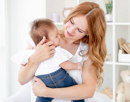 Photo pour Mother hugging baby - image libre de droit