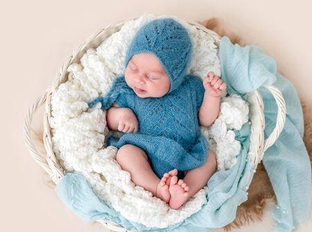 Photo pour Lovely newborn with tongue out - image libre de droit