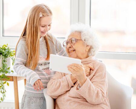 Photo pour Happy granny with granddaughter - image libre de droit