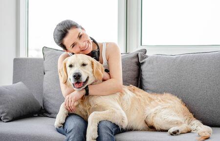 Photo pour Beautiful woman cuddling nice dog - image libre de droit