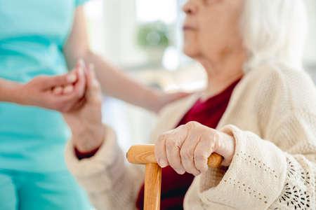 Photo pour Senior woman hand in caregiver hands - image libre de droit