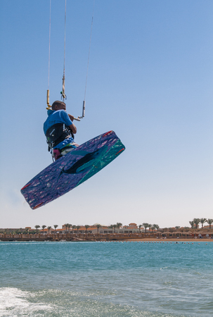 Man jumping on a kiteboard.