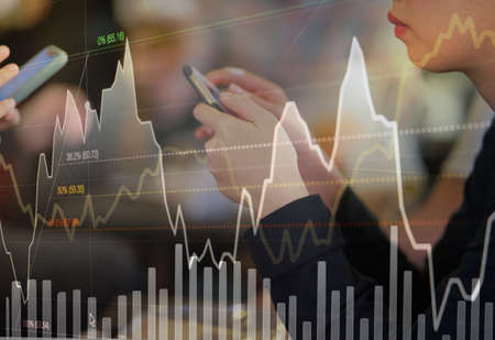 Photo pour Business person or stock trader are using smartphone for stock trading by graph indicator and price data analysis, stock technical chart analysis concept - image libre de droit