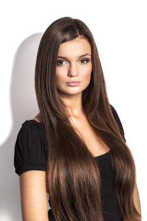 Photo pour Portrait of beautiful  woman with long brown hair on white background - image libre de droit