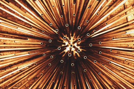 abstract of metal round tube dye in copper