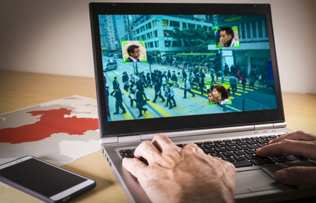Photo pour Laptop with street image and facial recognition in China - image libre de droit